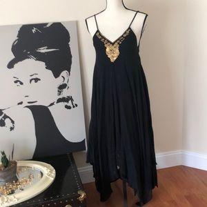 Medium black sun dress with gold tone jewel neck